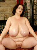 Fat middle aged woman Sapphire 38L shows off her big naturals before masturbating