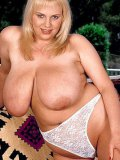 heavy titted blonde plumper takes off her dress to pose in white panties