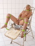 Lana S tied to a chair and in tight bondage while forced to piss in a small bowl.