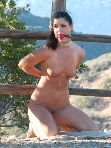 Sexy looking Milf India Summer in hardcore bondage with a young stud outdoors.