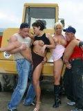Two horny hard dicked men fuck Jana Bach and Sharon Da Vale beside the bulldozer