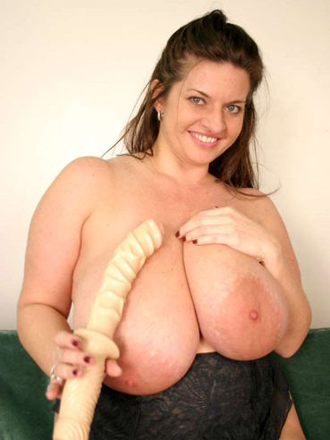 Smiling fattie Maria Moore puts long dildo between her shockingly big breasts