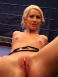 Lesbian fighters Blonde Cat and Aspen rub and fist their shaved pussies in the ring