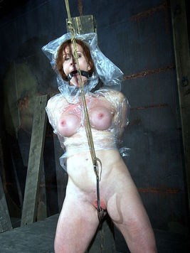 Man shows no mercy punishing big boobs and hairless pussy of red-haired slave Catherine De Sade