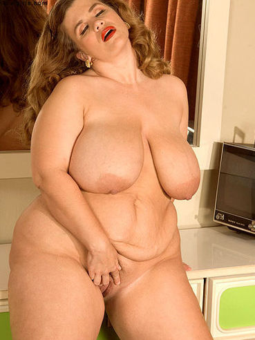 Big woman Hayley Jane with monster tits gets naked before she masturbates with dildo