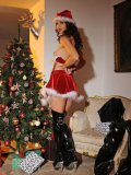 Fetish babe Aneta J ready for Christmas in her sexy outfit and long boots while getting naked.