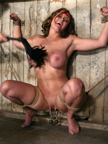 Busty slave mom Christina Carter in red shining boots gets tied and punished