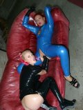 Janine La Teen and Jessica Night in tight crotchless latex suits take care of each others holes