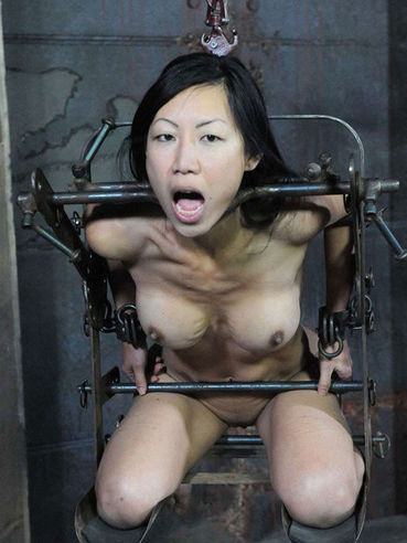 Asian slave Tia Ling with firm round boobs and smooth pussy gets bound and abused