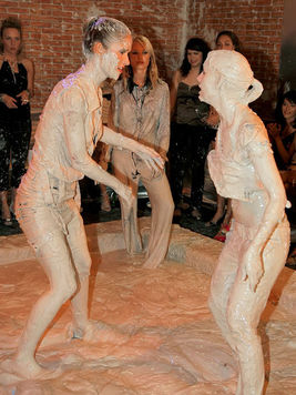 Lena Cova and Nessa Devil take part and mud wrestling and show their breastage