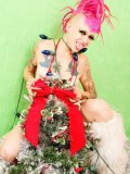 Petite alt chick Roxy Contin with pink hair and bald pussy pretends that she's the Xmas tree