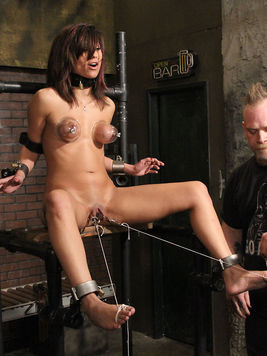 Shaved bound brunette Reena Sky gets every inch of her sexy body punished