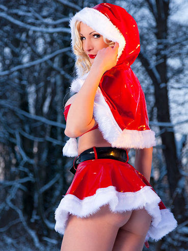 In this fetish gallery, delicious blonde Susan Wayland is wearing a Santa uniform.