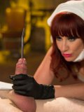 Fantastic maid Maitresse Madeline with big tits and red hair makes her twink lick her wet pussy.