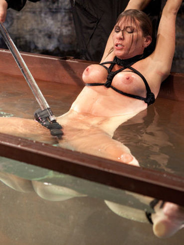 Ted up babe Ariel X gets her tits suctioned and stimulated during nasty aquaphilia and bondage.