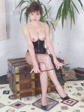 Lady Sonia topless in hot leather corset and sexy stockings posing and prepared for fetish action.