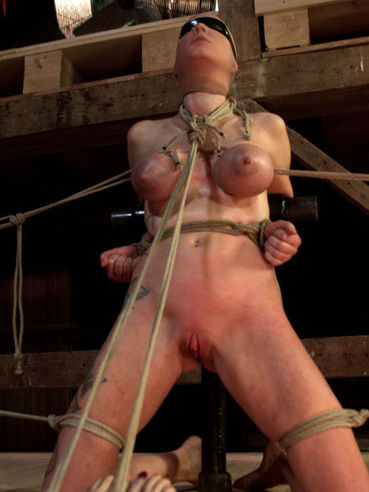 Fetish loving Ashli Orion tied up and getting her tits bound and shaved slit stimulated.