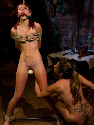 Zoe Voss gets a taste of Felony's hands while they are stimulating each other in kinky bondage.