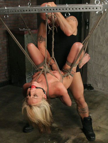 Bound chick's Val Malone legs are stretched to limits letting the master drill her holes.