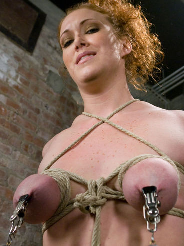 Helpless redhead Sabrina Fox with bald juicy pussy and fine curves gets tied up