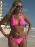 Sunbathing Lori Anderson in shades and pink bikini gives a close-up of her arm hair